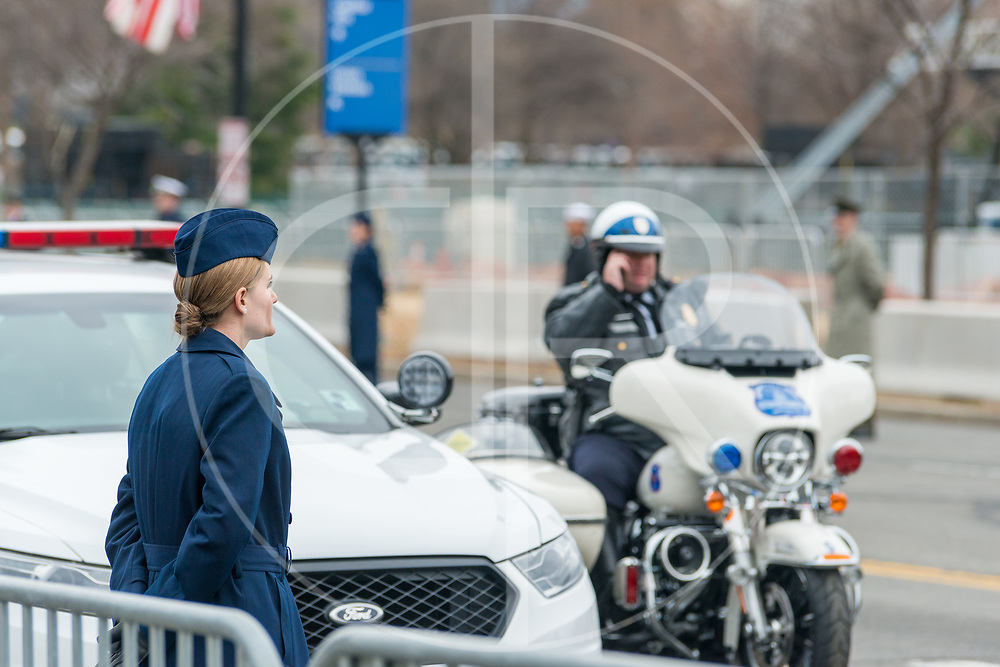 Washington DC, United States - Members of the U.S. Armed Forces and the D.C. Police get into place along Constitution Avenue, ahead of Trump's presidential motorcade.