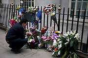 People gather on 5th anniversary of the July 7th 2005 bombings. Flowers are laid in memory of the victims of the 7/7 bombings in London. Here the memorial is on Tavistock Square, where the bus bombing took place.
