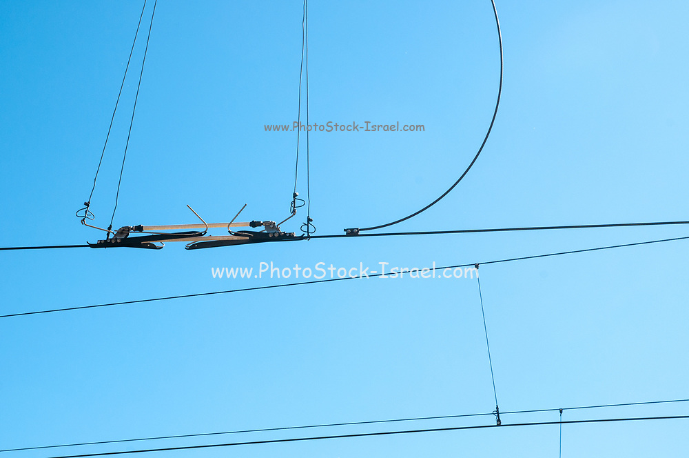 Electric train wires on blue sky background at the Rhaetian Railway Station, Samedan, Engadin valley, Switzerland