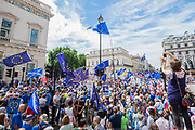 Gathering on Pall Mall in front of the Crimea War Memorial and the IOD - People's March for a People's Vote on the final Brexit deal.  Timed to coincide with the second anniversary of the 2016 referendum it is organised by anti Brexit, pro EU campaigners.