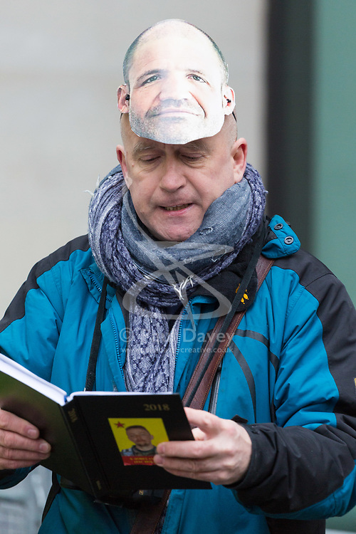 A supporter of James Matthews reads out the names of British volunteers killed in action against ISIS outside Westminster Magistrates Court where Matthews faces a charge of attending a place used for terrorist training, under the Terrorism Act 2006, after fighting against ISIS with the Kurdish YPG militia. London, February 14 2018.