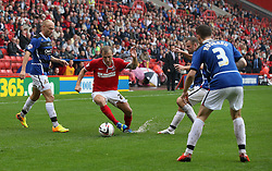 Charlton Athletic's Chris Solly dribbles his way through the Doncaster Rovers defence  - Photo mandatory by-line: Robin White/JMP - Tel: Mobile: 07966 386802 24/08/2013 - SPORT - FOOTBALL - The Valley - Charlton -  Charlton Athletic V Doncaster Rovers - Sky Bet League Two