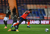 Football - 2020 / 2021 EFL Carabao Cup - Round Three - Luton Town vs Manchester United<br /> <br /> Luton Town's Kazenga LuaLua holds off the challenge from Manchester United's Fred, at Kenilworth Road.<br /> <br /> COLORSPORT/ASHLEY WESTERN