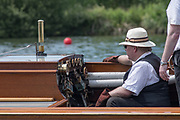 """Henley. Berks, United Kingdom. <br /> <br /> Steam Launch, """"Consulta"""" """"The Stoker"""" keeps an eye on the Dails, during a race at the 2017 Henley' Women's Regatta. Rowing on, Henley Reach. River Thames. <br /> <br /> <br /> Saturday  17/06/2017<br /> <br /> <br /> [Mandatory Credit Peter SPURRIER/Intersport Images]"""