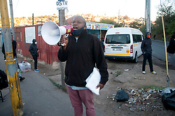 Pastor Mboglela telling people at a Mayville taxi rank how to social distance themselves.