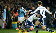 Stephane Sessegnon wins the ball during the The FA Cup match between West Bromwich Albion and Gateshead at The Hawthorns, West Bromwich, England on 3 January 2015. Photo by Alan Franklin.