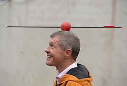 Pictured: Scottish Liberal Democrat leader Willie Rennie tried his hand at archery on a campaign visit to Ainslie Park leisure centre in Edinburgh.<br /> <br /> © Dave Johnston / EEm