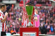 Lincoln City's Luke Waterfall with his hands on the Trophyduring the EFL Trophy Final match between Lincoln City and Shrewsbury Town at Wembley Stadium, London, England on 8 April 2018. Picture by John Potts.