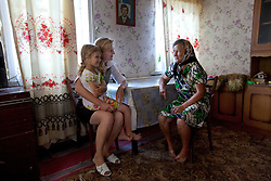 Vita Kalembet, a paralegal, visits Anastasia Yarekha, 6, whose mother was murdered in a domestic violence dispute, Poltava, Ukraine, June 18, 2011. Anastasia's grandmother, Nadia Yarekha, came to Kalembet looking for guidance on how to legally adopt her granddaughter. More than half of the worldÕs population, four billion people live outside the rule of law, with no effective title to property, access to courts or redress for official abuse. The Open Society Justice Initiative is involved in building capacity and developing pilot programs through the use of community-based advocates and paralegals in Sierra Leone, Ukraine and Indonesia. The pilot programs, which combine education with grassroots tools to provide concrete solutions to instances of injustice, help give poor people some measure of control over their lives.