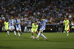 September 26, 2018 - Leganes, Madrid, Spain - Gerard Gumbau (CD Leganes) competes for the ball with Coutinho (FC Barcelona) during the La Liga match between CD Leganes and FC Barcelona at Butarque Stadium in Leganes. (Credit Image: © Manu Reino/SOPA Images via ZUMA Wire)