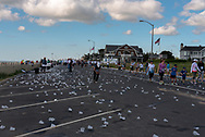 Spring Lake NJ, USA -- May 27, 2017 A long trail of discarded water cups is on the street as the race begins to wind down. Editorial use only.