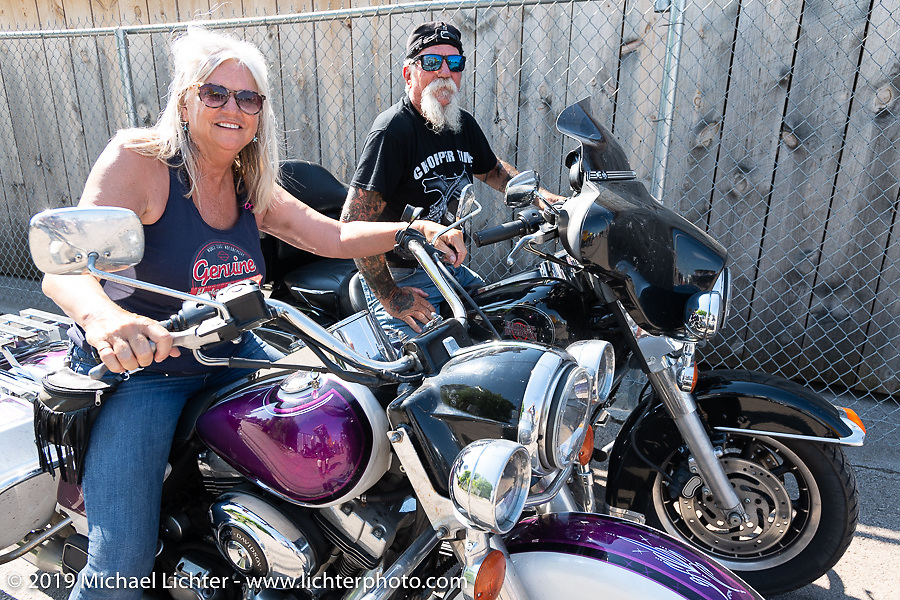 Mailman Kevin O'Brien and Mrs Mailman (Cheryl O'Brien) leaving on Aidan's Ride from the Iron Horse Saloon during the Sturgis Black Hills Motorcycle Rally. Sturgis, SD, USA. Tuesday, August 6, 2019. Photography ©2019 Michael Lichter.
