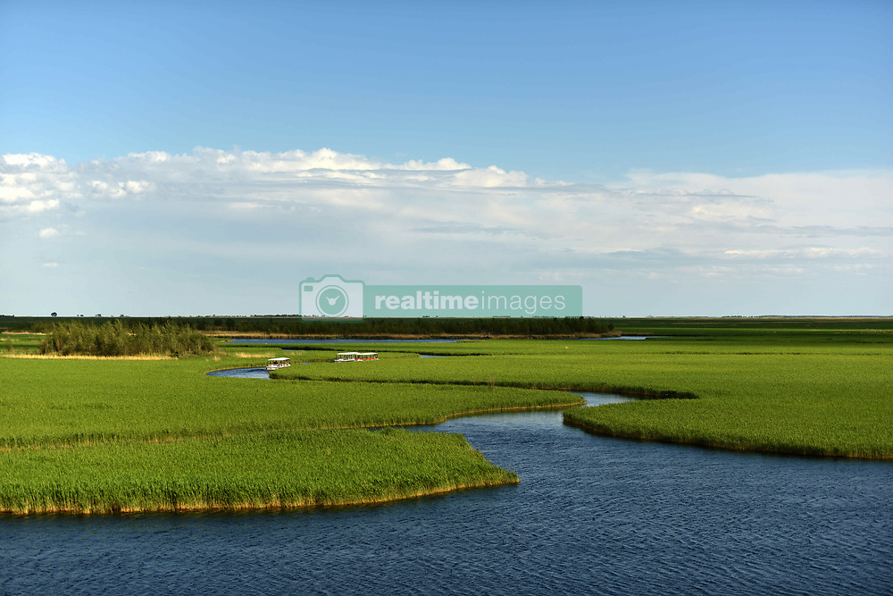 April 26, 2018 - Qiqihar, Qiqihar, China - Qiqihar, CHINA-26th April 2018: Scenery of Zhalong Nature Reserve in Qiqihar, northeast China's Heilongjiang Province. Zhalong Nature Reserve, located in the western part of Heilongjiang Province, is a well-preserved primitive wetland reserve. Covering an area of 2,100 square kilometers (210,000 hectares), this marshland is a major migratory route for birds from the Arctic to South East Asia. The reserve serves as a stopover and nesting area for a large number of storks, swans, herons, grebes and other species. Its ponds and reeds make it an ideal home for over 300 different species of birds, including six kinds of cranes, especially red-crowned cranes. (Credit Image: © SIPA Asia via ZUMA Wire)
