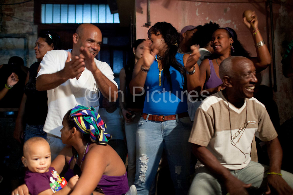 San Lazaro ceremony in December in a private Cabildo in Havana. Santeria is a syncretic religion practiced in Cuba, it is a mixture of Yoruba tribal practices brought from Nigeria during Colonial times, and traditional Catholic beliefs. During this time, the slaves used the images of saints to cover up their worship of the Orishas (spirits)