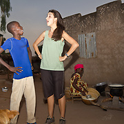 Peace Corps volunteer Rachael has a laugh with one of boys of Koumbadiouma, back in the village from his studies for Islamic New Year. Kolda, Senegal.
