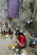 Rickshaw driver Munna Kailash and his wife Meera eat lunch in their courtyard in Varanasi, India.  (Muna Kailash is featured in the book What I Eat: Around the World in 80 Diets.) MODEL RELEASED.