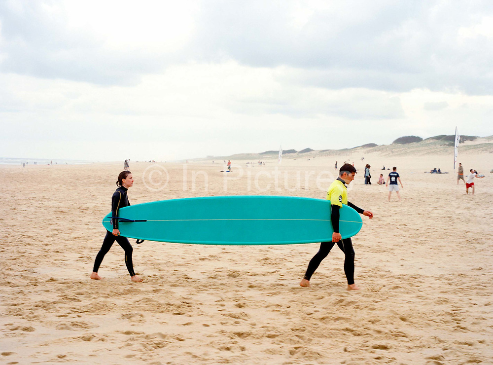 Jan and Virginie return from the water not entirely happy with their performance at   the French Tandem Surfing Finals.  Surprisingly rarely for this sport, they are a couple on and off the water which might explain why they were arguing and why they left the event shortly after the picture was taken.
