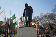 With the statue of former Prime Minister Sir Winston Churchill in the foreground, the flags of all Commonwealth Nations hang in Parliament Square on the occasion of the bi-annual Commonwealth Heads of Government Meeting (CHOGM),  on 19th April 2018, in London, England.