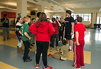 """Nike Ambassador James McDonald goes over the rules for """"capture the football"""" during Laconia Middle School's after school program on Thursday.  (Karen Bobotas/for the Laconia Daily Sun)"""