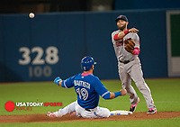 May 10, 2015; Toronto, Ontario, CAN; Boston Red Sox second base Dustin Pedroia (15) turns a double play as Toronto Blue Jays designated hitter Jose Bautista (19) slides to seconds base in eighth inning  at Rogers Centre. Red Sox beat Blue Jays 6 - 3 Mandatory Credit: Peter Llewellyn-USA TODAY Sports