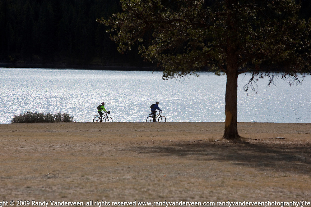 Photo Randy Vanderveen.Jasper AB.02/10/09.Cyclists pedal along the shores of Lake Edith on a September afternoon.