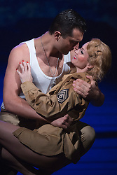 "© Licensed to London News Pictures. 16/10/2013. London, England. Pictured: Rebecca Thornhill as Karen and Darius Campbell as Warden. The Musical ""From Here to Eternity"" opens at the Shaftesbury Theatre on 23 October 2013 starring Darius Campbell, Siubhan Harrison, Robert Lonsdale and Rebecca Thornhill. This brand new musical is directed by Tamara Harvey and lyrics by Tim Rice, music by Stuart Brayson and script by Bill Oakes. Photo credit: Bettina Strenske/LNP"