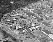 """Ackroyd 19264A-05. """"City of Portland. Aerials. March 27, 1975"""" Guilds Lake, Schmitt Steel 2765 NW Nicolai St The curved street is Nicolai turning into St. Helens. The straight street on the right is NW Industrial."""