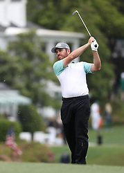 April 7, 2018 - Augusta, GA, USA - Louis Oosthuizen hits from the 1st fairway during the third round of the Masters Tournament on Saturday, April 7, 2018, at Augusta National Golf Club in Augusta, Ga. (Credit Image: © Jason Getz/TNS via ZUMA Wire)