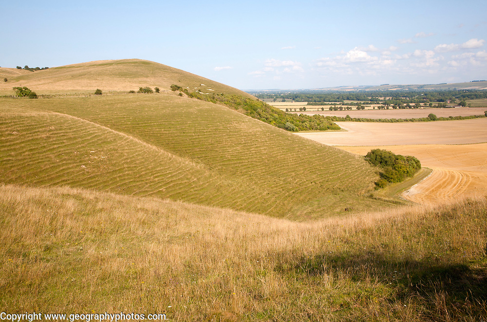 Steep chalk scarp slope and the Vale of Pewsey looking east from near Alton Barnes, Wiltshire, England, UK