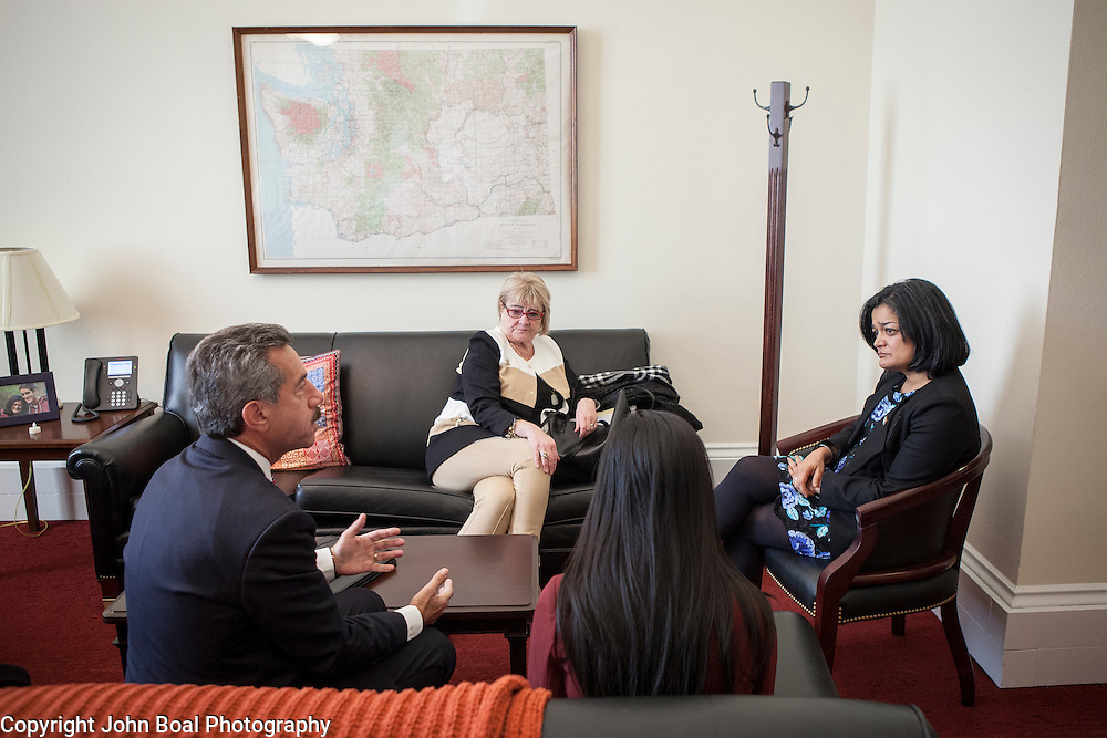 Representative Pramila Jayapal (D-WA, 7) and her legislative assistant, Jennifer Chan, second from right, meet with James Pishue, President and CEO, and Gloria Stewart of the Washington Bankers Association, on Tuesday, January 31, 2017.  John Boal photo/for The Stranger