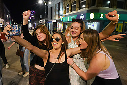 © Licensed to London News Pictures. 28/08/2021. Leeds, UK.  Revellers make the most of the Bank Holiday weekend in Leeds. Photo credit: Ioannis Alexopoulos/LNP