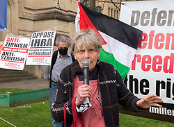 © Licensed to London News Pictures;31/03/2021; Bristol, UK. Retired academic and member of Brighton Palestinian Solidarity Campaign Dr. SANDY KENNEDY speaks at a coalition of Labour Left organisations including Labour Campaign for Free Speech and speakers hold a lobby in defence of academic freedom and Professor David Miller outside Bristol University. Around 50 protesters assembled at 2pm outside the Wills Memorial Building to express solidarity and support for Professor Miller who has been suspended by the University of Bristol over allegations of anti-semitism. Speakers included Dr. Eldin Fahmy, Senior Lecturer of Policy Studies at University of Bristol, Sandy Kennedy, a former graduate from Bristol University, who has worked in an Israeli Kibbutz, and there were messages of support from Roger Waters, Alexei Sayle, Chris Williamson MP, Ken Loach, and Jonathan Cook. Photo credit: Simon Chapman/LNP.