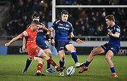 Leicester Tigers Johnny McPhillips kicks the ball through as Sale Sharks centre Sam James and stand-off Rob Du Preez try to block with their feet during a Gallagher Premiership Rugby Union match, Sale Sharks -V- Leicester Tigers, Friday, Feb. 21, 2020, in Eccles, United Kingdom. (Steve Flynn/Image of Sport via AP)