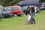 A Union soldier in uniform and a civilian in period dress walk through the parking lot during a Civil War reenactment hosted by the 124th New York State Volunteers at the Orange County Farmers Museum on Sept. 23, 2006