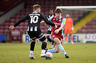 Scunthorpe United Lewis Spence (20) defending during the EFL Sky Bet League 2 match between Scunthorpe United and Grimsby Town FC at the Sands Venue Stadium, Scunthorpe, England on 23 January 2021.
