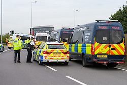 © Licensed to London News Pictures. 13/09/2021. Staines, UK. Police vehicles parked up on Poyle Interchange as protester's from climate campaign 'Insulate Britain', an offshoot of Extinction Rebellion (XR), block the clockwise slip road at Poyle Interchange/junction 14, M25 London Orbital Motorway. Photo credit: Peter Manning/LNP