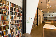 Shelves full of artists' sketchbooks, all part of the Sketchbook Project at the Boroklyn Art Library.