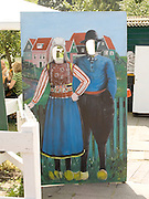 a take my picture board with traditional dressed people painted on it Marken Holland