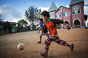 Young boys play soccer in front of the local church in Mindat, Chin State, Myanmar.
