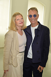 JO MILLER and JOHN MAYBURY at a lunch in aid of the charity African Solutions to African Problems (ASAP) held at the Louise T Blouin Foundation, 3 Olaf Street, London W11 on 21st May 2014.