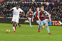 Football - 2017 / 2018 Premier League - Swansea City vs. Burnley<br /> <br /> Jordan Ayew of Swansea City tricks the Burnley defence to attack along the goalie , at The Liberty Stadium.<br /> <br /> COLORSPORT/WINSTON BYNORTH