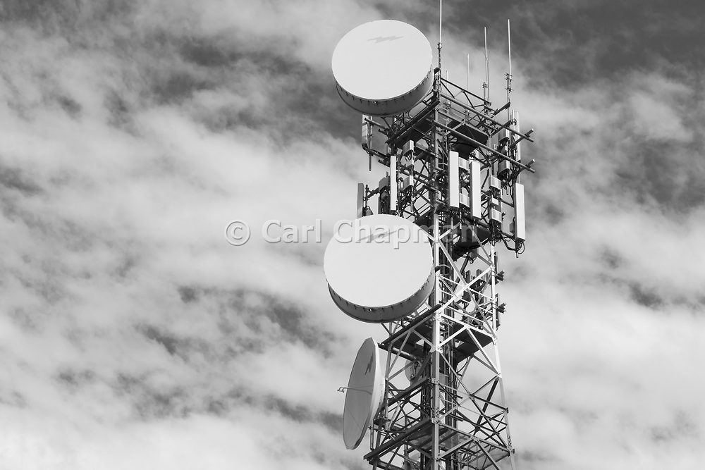 cellular and microwave antennas on a red and white communications tower in Narrabri, New South Wales, Australia <br /> <br /> Editions:- Open Edition Print / Stock Image