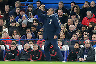 Chelsea Manager Mourizio Sarri gestures and Manchester United interim Manager Ole Gunnar Solskjaer looks on during the The FA Cup 5th round match between Chelsea and Manchester United at Stamford Bridge, London, England on 18 February 2019.
