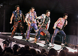 NSync performs their opening number in a concert at Giants Stadium in East Rutherford, New Jersey. From left: Chris, Justin, Joey and J.C. Lance is hidden behind Justin.