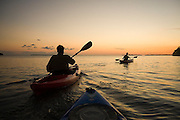 Kayakers paddle into the sunset in Everglades National Park, Florida.