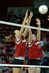 06 November 2004....Emily Kabbes and Laura Doornbos join for a block attempt....Illinois State University Redbirds V SouthWest Missouri State University Bears Volleyball.  Redbird Arena, Illinois State University, Normal IL..Illinois State Redbirds v Southwest Missouri State