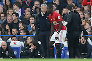 Jose Mourinho, the Manchester United manager talking to Eric Bailly of Manchester United after he comes off injured. Premier league match, Chelsea v Manchester Utd at Stamford Bridge in London on Sunday 23rd October 2016.<br /> pic by John Patrick Fletcher, Andrew Orchard sports photography.