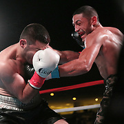 Miguel Cruz of Puerto Rico (R) punches Ali Mammadov of Azerbaijan during the Puerto Rico vs The World boxing event at Orlando Live Events Center on Friday, March 24, 2017 in Casselberry, Florida.  (Alex Menendez via AP)