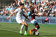 Michail Antonio of West Ham United (R) is tackled by Federico Fernandez of Swansea City (L )and then pulls up with a hamstring injury. Premier league match, West Ham Utd v Swansea city at the London Stadium, Queen Elizabeth Olympic Park in London on Saturday 8th April 2017.<br /> pic by Steffan Bowen, Andrew Orchard sports photography.