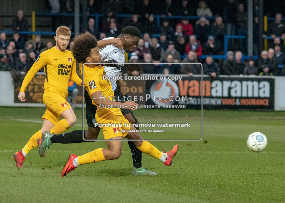 DOVER, UK - DECEMBER 29: Joe Widdowson of Leyton Orient challenges Inih Effiong of Dover Athletic during the Vanarama National League match between Dover Athletic and Leyton Orient at the Crabble Stadium on December 29, 2018 in Dover, UK. (Photo by Jon Hilliger)